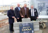 DXM. Pose de la 1ère pierre du siège social aux Hauts de Sévigné
